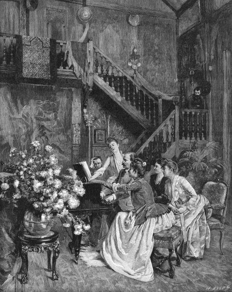 A family gather round the piano, whilst a man looks down on them from the stairs. Date: 1880s