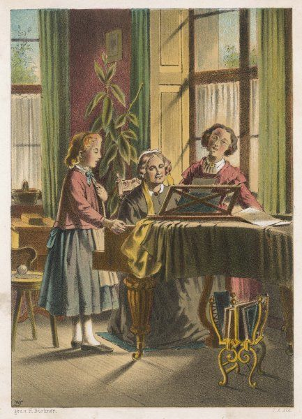 Two women and a girl making music at the piano