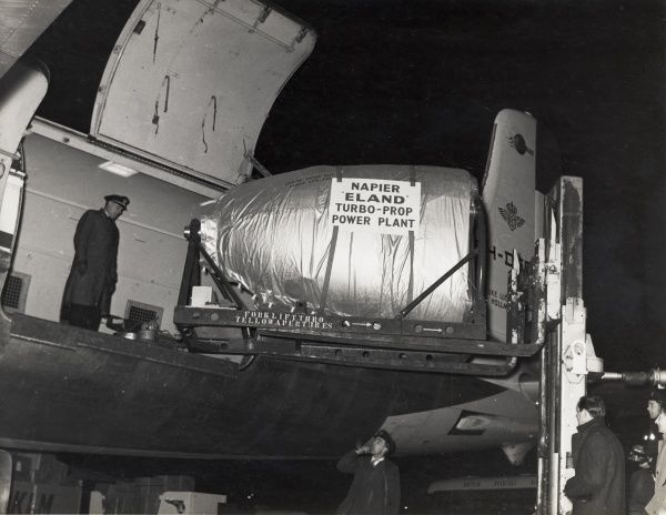 Napier Eland turbo-prop power plant being loaded onto an aircraft at Heathrow Date