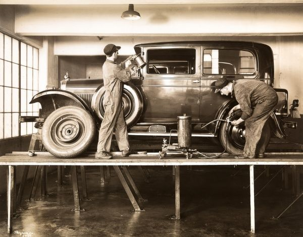 Warren. Nash Motor Corporation, Greasing Shackles and Hinges. - Two mechanics working on a Nash auto at the Warren