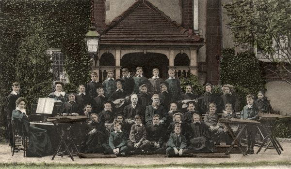 The Birmingham branch of the home and orphanage run by the National Children's Home (NCH). Here, the home's choir are seen together with a number of musical instruments including mandolins, dulcimers and a piano. Date: Date unknown