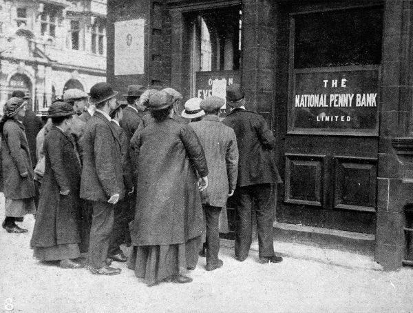 Photograph showing a crowd of people outside the closed National Penny Bank in Queen Victoria Street, London. Many banks closed beyond the Bank Holiday after the proclamation of war in 1914 to prevent 'money panic&#39