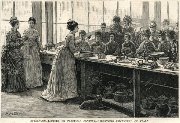 An afternoon 'practical cookery' lecture at the National Training School of Cookery, South Kensington. The female students are learning how to season 'Fricandeau of Veal'. A dog sits beside the lecturer. Date: 1874