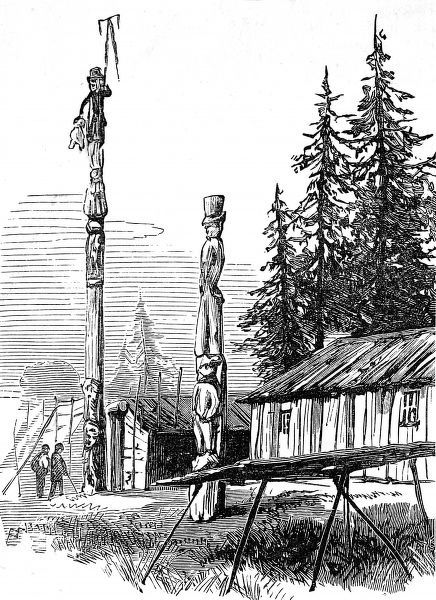Image showing several monumental totem poles outside native American Indian dwellings, British Columbia, 1882. The figures on the totem poles are dressed in a mixture of Indian and European dress