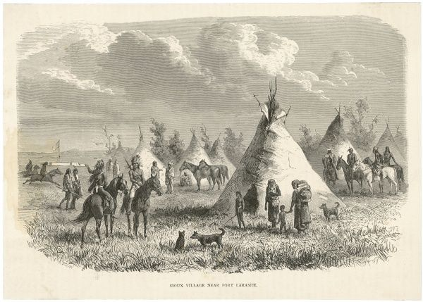 A Native American Sioux village near Fort Laramie, Wyoming, USA -- men, women and children go about their daily chores