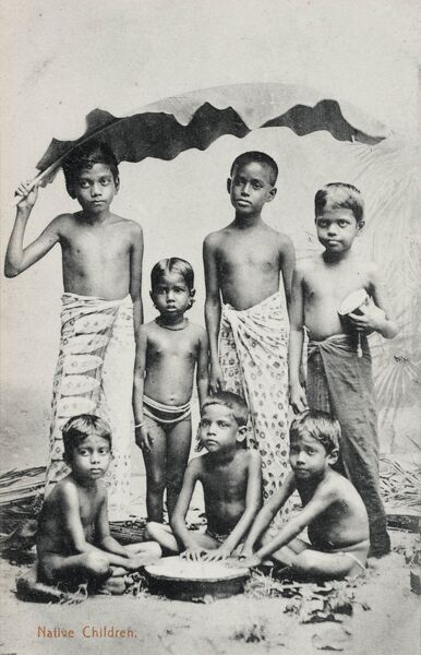 Native Children - Sri Lanka - the boy standing on the left is shading his fellows with a large banana leaf