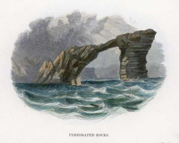 Perforated rocks sticking out of the sea form an arch