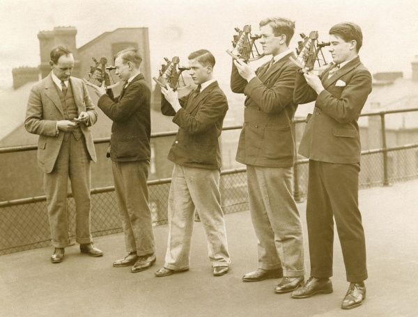Young men, students at the London School of Engineering and navigation, learning how to take a bearing by sextant to find the position of a ship when out at sea. Date: 1930s