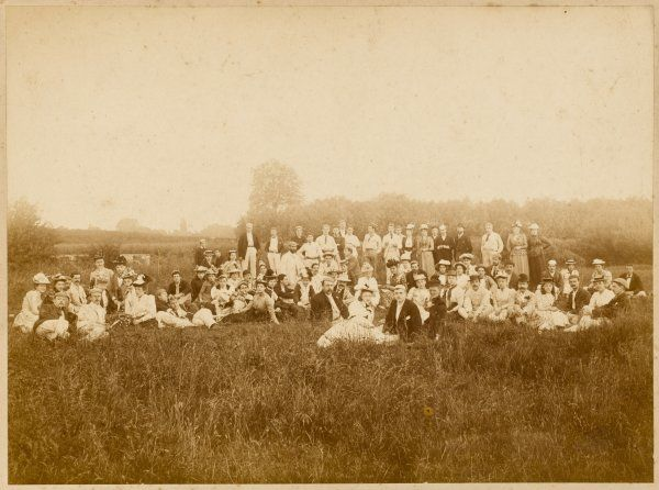 Members of the Nautilus Swimming Club, based at Camberwell Baths in south-east London, pose in a meadow before settling down to their River Picnic