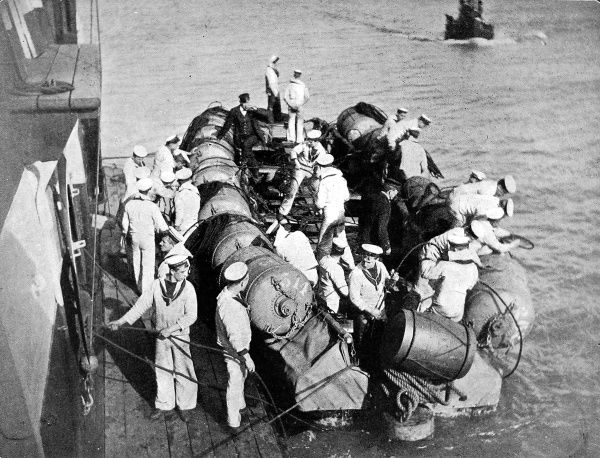 Men of the Red Fleet of the British Navy preparing mines to protect the Thames and Medway area during naval manoeuvres in 1906