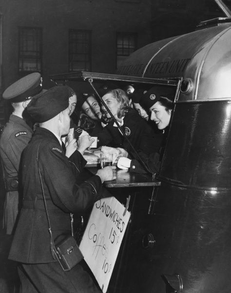 Navy League Canteen unit charges for their wares for the first time, but for charity only, during World War II in England