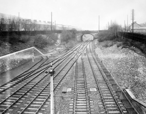 View of the track, with a road bridge in the middle distance, near Skewen Railway Station on the Great Western Railway, Glamorgan, South Wales