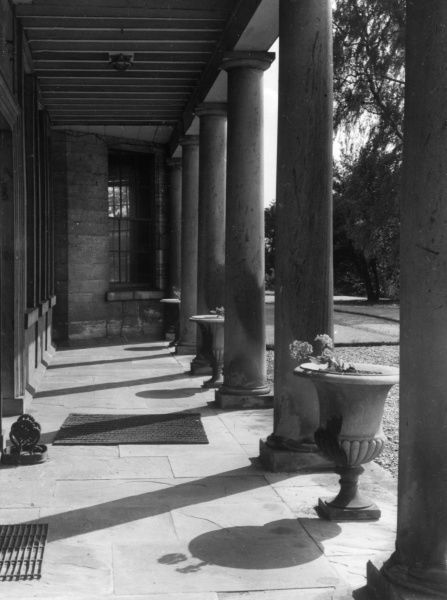 A Neo Classical colonnade at a country mansion, Newton Kyne, near Tadcaster, Yorkshire, England. Date: 18th century