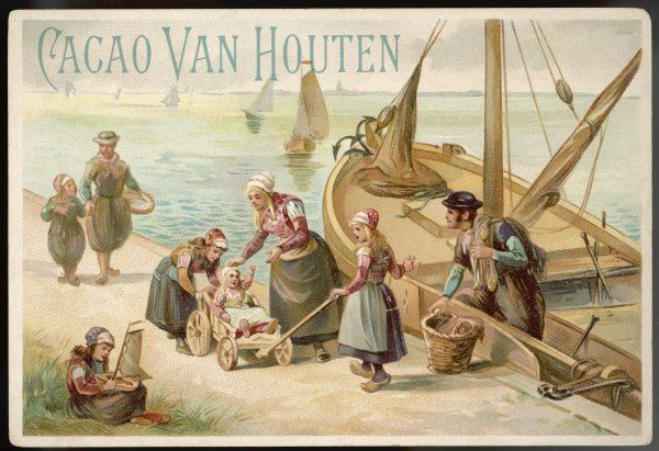 Men, women and children of a Dutch fishing community : note the wooden pram