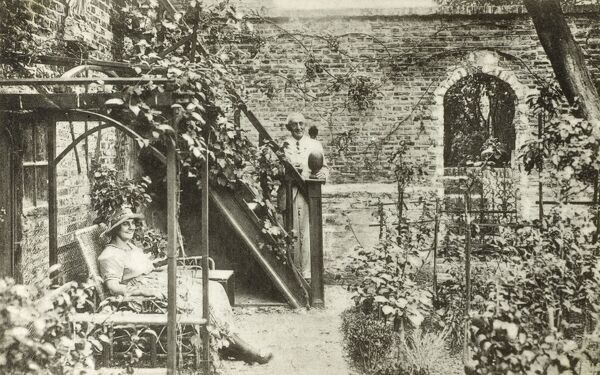 An elderly couple in the garden of a Scottish House in Veere, a city in the southwestern Netherlands, on Walcheren island in the province of Zeeland. Veere was the principal port used by Scottish wool traders in dealings with the Dutch between 1541 and 1799