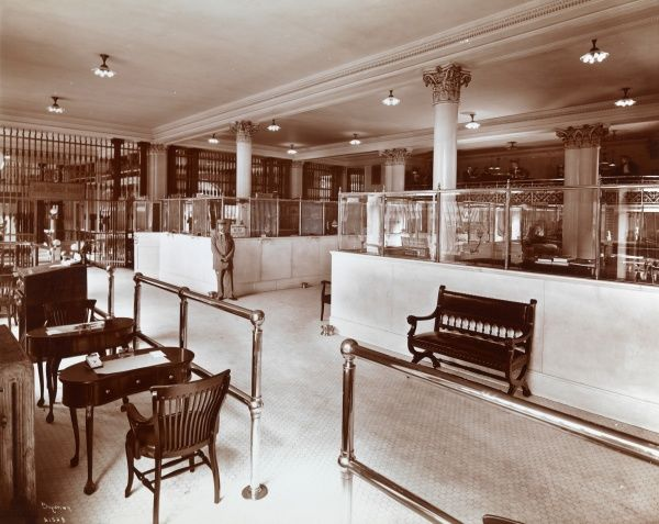 Banks, New Amsterdam. Interior of New Amsterdam Bank at 40th Street & Broadway with tellers' windows, desks and chairs