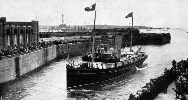 The 'Galatea' cutting the ribbons across the mouth of the new Gladstone Dock at Liverpool in 1913