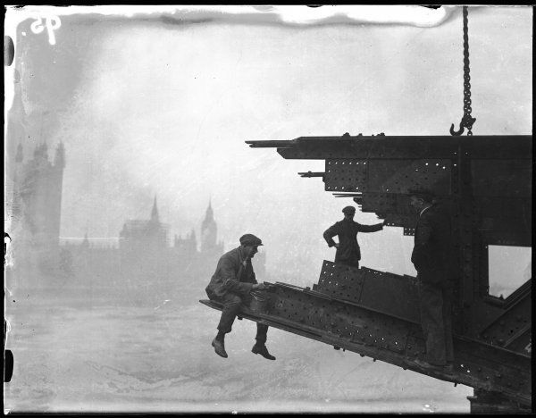 Workmen painting the first span of the new Lambeth Bridge, a five span bridge designed by George Humphreys opened by George V and Queen Mary in 1932