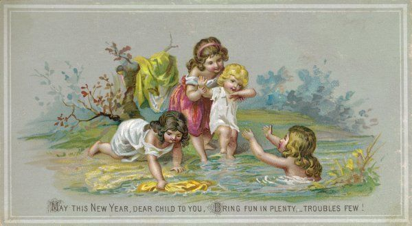 Four children playing in a stream and having fun