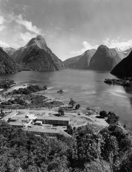 Hotel Milford, in its setting at the head of Milford Sound, Otago, New Zealand. Date: 1950s