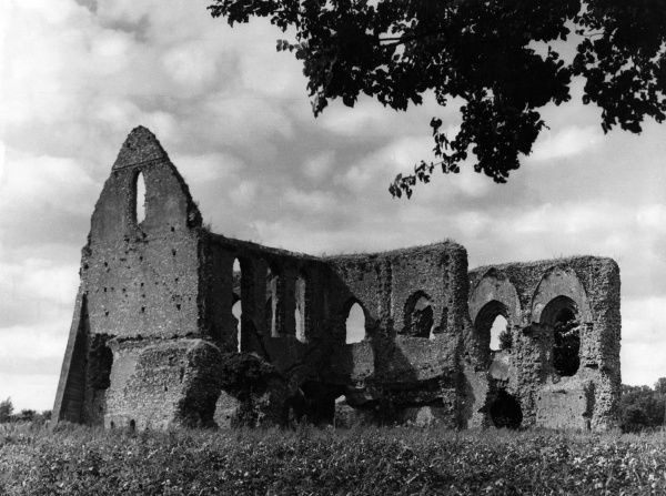 The imposing ruins of Newark Priory, at Pyrford, Surrey, England, almost surrounded by the waters of the River Wey. Date: 13th century
