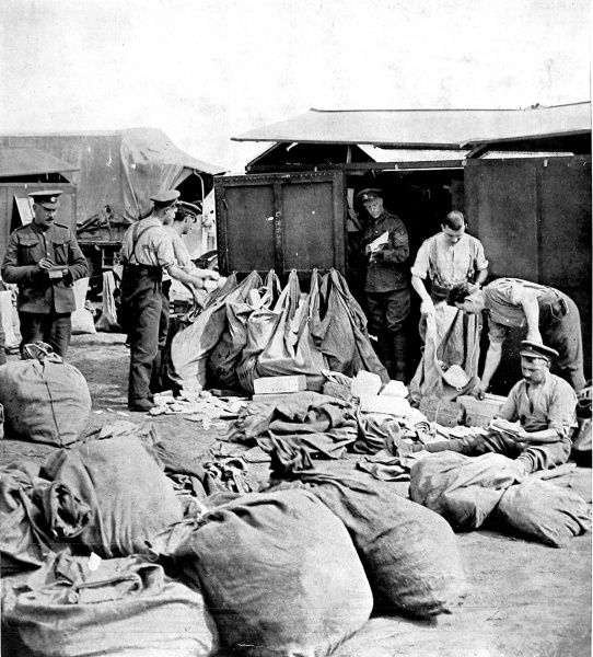 A photograph of British soldiers sorting letters from home on the Western front, August 1916