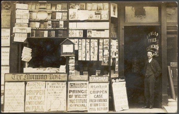"A newsagent's shop at the time of the Crippen case with a billboard announcing ""Fresh evidence at Bow Street - Full Report&quot"