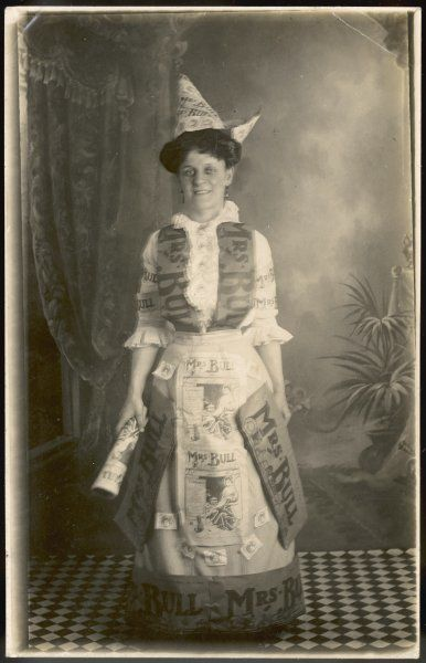 MRS BULL; a woman dressed in pages from the newspaper