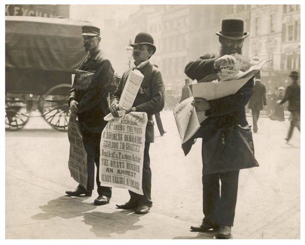 Three newsmen sell their broadsheet newspapers at Ludgate Circus