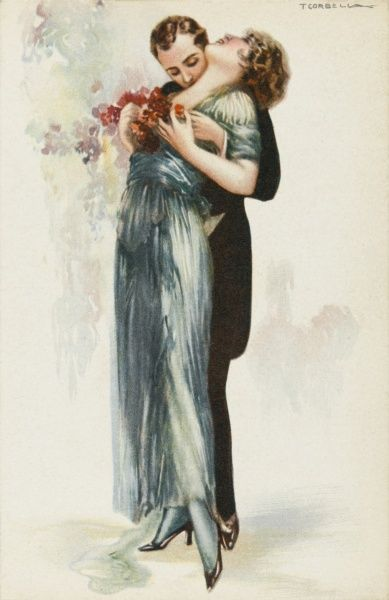 He in a dark suit, she in a long green dress. He kisses her upon the neck while she clasps a garland of flowers