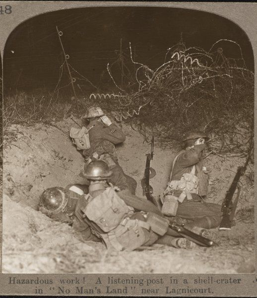 Four British soldiers at a listening post in a shell crater in No Man's Land near Lagnicourt