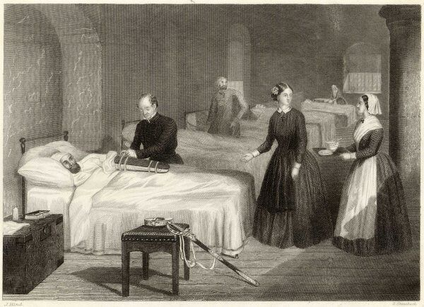 In Scutari, Florence Nightingale assists while a doctor puts a splint on a patient's arm