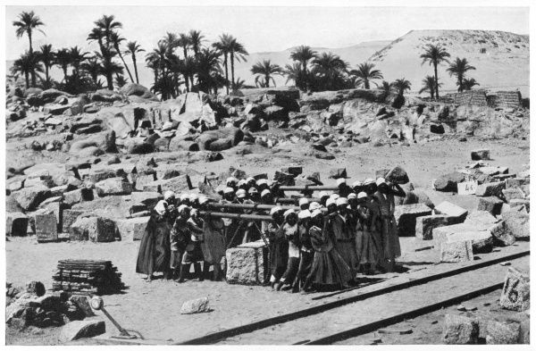 NILE DAM Stone porters transporting a granite lintel weighing three tons to be used in the construction of the Nile dam