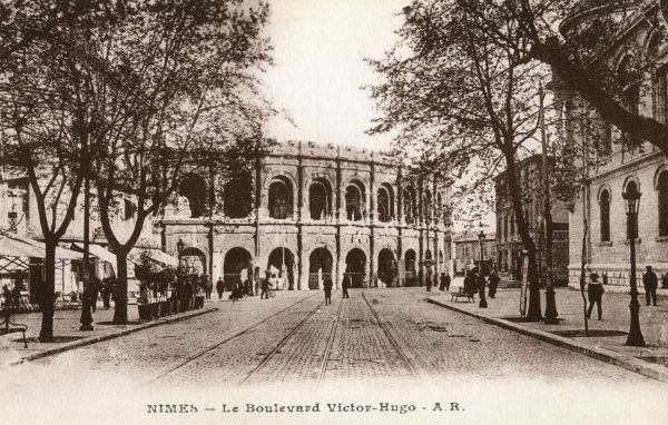 Follow the boulevard Victor- Hugo and you'll find yourself at the Roman arena. Date: circa 1900