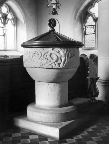 The font, with its Norman Bowl, at St. Helen's Church, Thorby, Northamptonshire, England. Date: 11th - 12th century