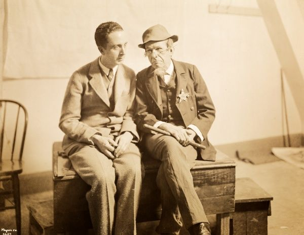New School of Design, Mr. Norman Rockwell (left) & Model-Mr. Van Veckten. Portrait of Norman Rockwell seated next to his model, Mr. Van Veckten, on a bench at the New School of Design, 1680 Broadway