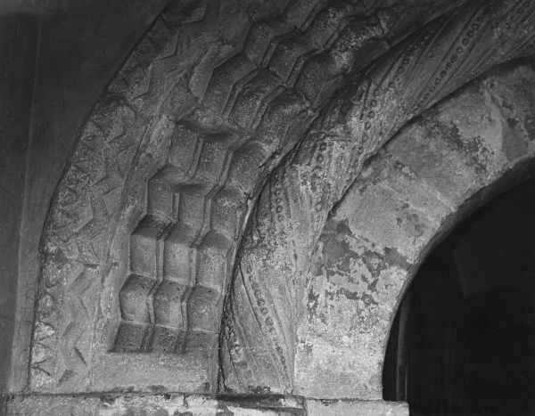Detail of Norman stonework, around a doorway at Broxford Church, Hampshire, England. Date: 11th century