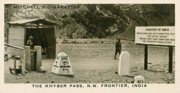 North West Frontier Province - Entrance to Khyber Pass - the border post. A sign points to the 'Limit of British India' to the left