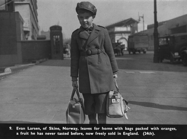Evan Larsen, of Skine, Norway, leaves for home with bags packed with oranges, a fruit he had never tasted before but was being freely sold in England by the late 1940s. c.1946