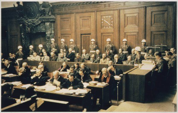The defendants at the Nuremberg Trial listen to the proceedings as they are tried for crimes against peace, humanity and defenceless minorities