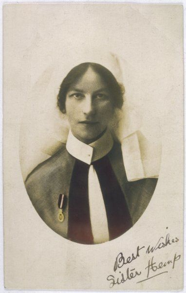"Head and shoulders photograph of a nurse, inscribed ""Best wishes, Sister Hemp&quot"