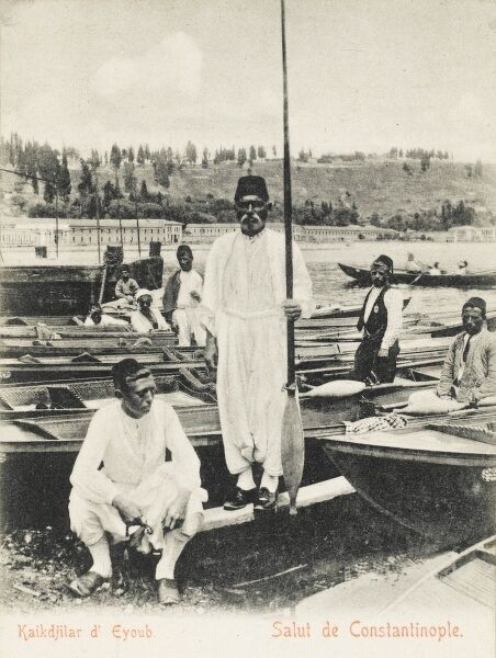 Oarsmen with their boats at Eyup, Constantinople, Turkey. Close to the entrance to the Silver Horn