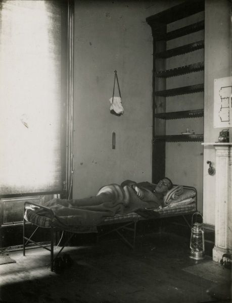 "Photograph of an observer asleep on a bed in ""Base Room"", during investigations at Borley Rectory, 21 November 1937. HPG/1/3/7 ()&quot"