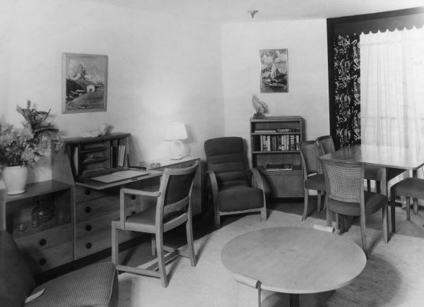 A practical, 'modern', office diner, with a bureau and dining table. Date: 1930s