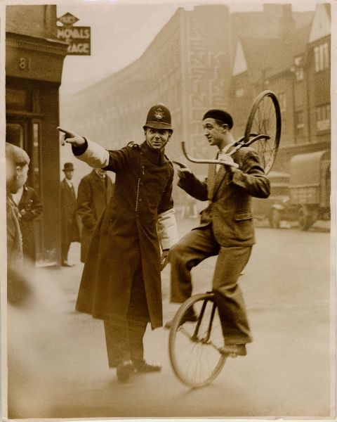 Police Constable on point duty directing a member of Bertram Mills Circus to Olympia, Hammersmith, London