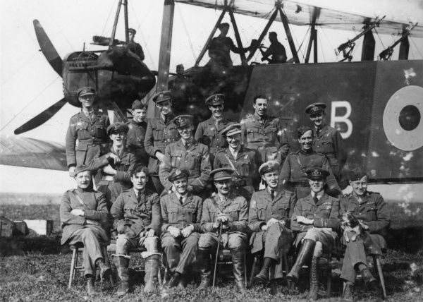 Officers of 207 Squadron of the Independent Air Force in a group photo in front of a Handley Page bomber plane during the First World War. Date: 1918