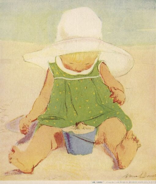 A toddler sits playing in the sand on a beach wearing a green sun dress and a huge wide brimmed sun hat, and is surprised to see a small crab appear in her bucket of sand