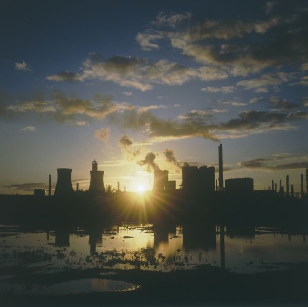 Sunset over an oil refinery near Swansea, South Wales