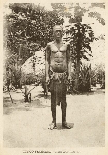 Elderly Chief of the Bacouli Tribe in the French Congo (the present-day area of the Republic of the Congo, Gabon, and the Central African Republic). Date: circa 1910s