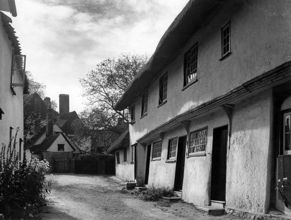 Lovely old cottages such as these at Clavering, Essex, England, appeal to us all, with their simplicity of structure. Date: 1930s